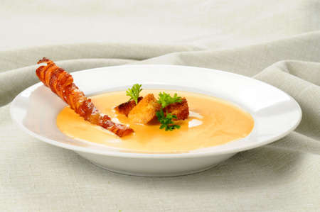 croutons: Cheddar Cheese Soup garnished with croutons and bacon. Stock Photo