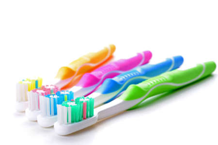 Four very colorful toothbrushes on a white background. Imagens - 8061758