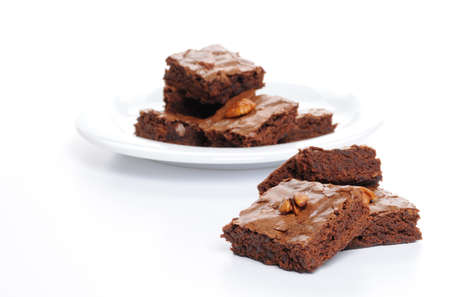 Fresh baked brownies shot on a white background.