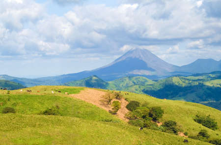 Landscape showing Costa Rica pastureland with Arenal Volcano in the background.