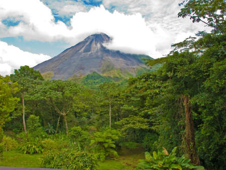 volcanos: Costa Rican jungle landscape with the arenal volcano in background. Stock Photo