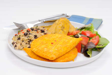 pinto beans: Meal consisting of meat patties, gallo pinto and fried plantain.