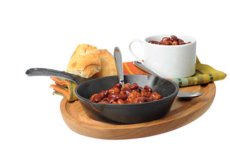 skillet: Skillet of delicious and spicy baked beans.