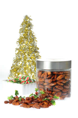 Delicious homemade spicy candied almonds in a jar. Imagens - 8424959