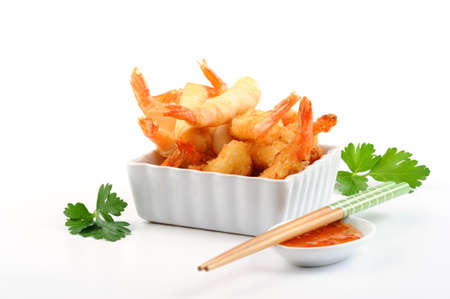 Oriental shrimp rolls and coconut shrimp with spicy orange dipping sauce. Imagens - 8470570