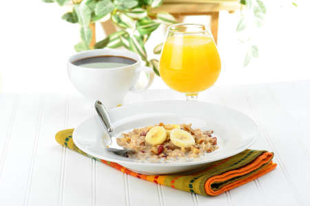 oatmeal: Delicious breakfast consisting of oatmeal, orange juice and coffee.