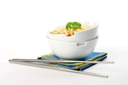 Bowls of oriental style noodles on a white background.