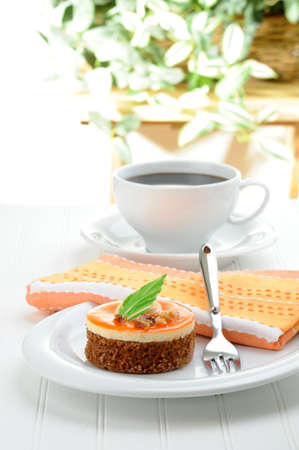 A nontraditional carrot cake served with fresh coffee. Imagens