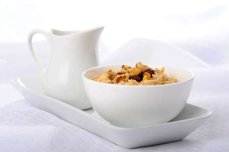 oatmeal: Bowl of delicious oatmeal with raisins and chopped walnuts.