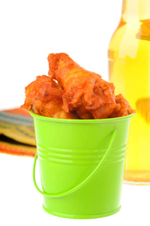 beer bucket: Bucket of hot and spicy chicken wings. Stock Photo