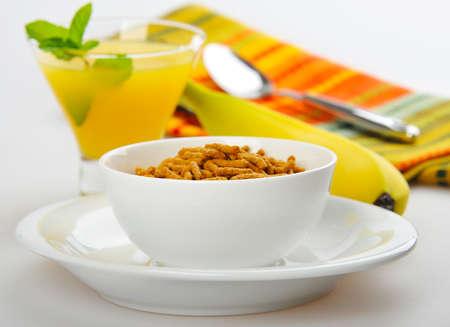 Healthy breaksfast of bran cereal with orange juice and fresh fruit.