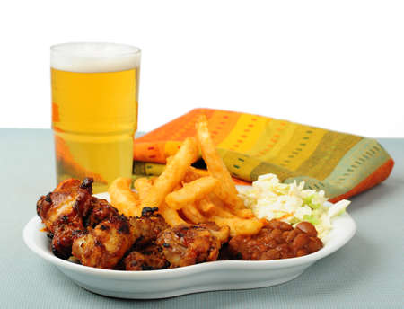 barbecued: Plate of delicious barbecued chicken wings with beer.