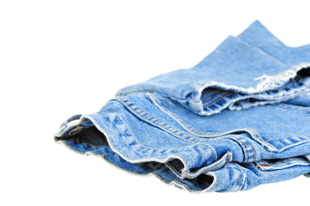 Pair of faded denim jeans on a white background.