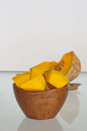 cubed: Bowl of raw cut and cubed autumn squash