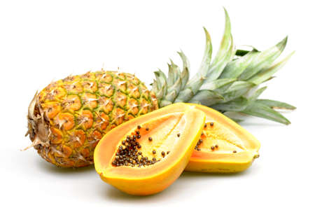 Papaya and pineapple photographed on a white background.