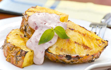 Grilled pineapple topped with a raspberry infused cream.
