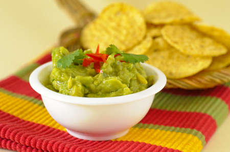 Serving of freshly made guacamole served with chips. Imagens - 18365315