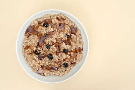 oatmeal: Overhead view of a bowl of maple raisin oatmeal. Stock Photo