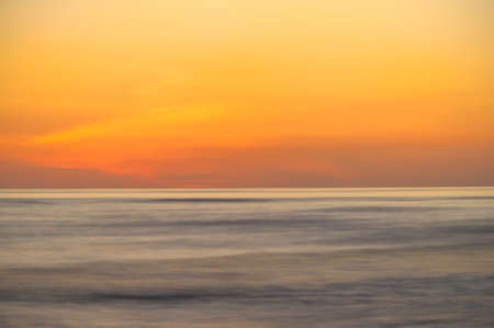 Long exposure of a blazing orange sunset as seen over the Pacific off Costa Rica. photo