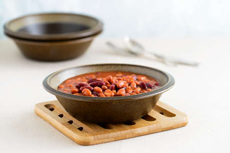 hearty: Hearty bowl of slow baked beans in a sauce.