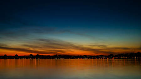 Sunset over Kempenfelt Bay and the City of Barrie Ontario skyline.