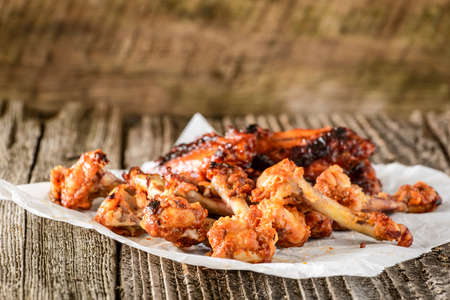 barbecued: Pile of bones from already eaten barbecued chicken wings.