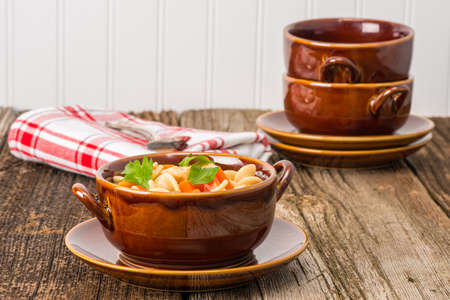 soup bowl: Bowl of hearty turkey soup made with leftover holiday meat.
