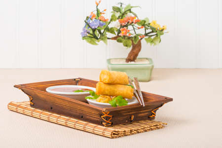 spring roll: Spring roll appetizers served with a sweet and spicy sauce.