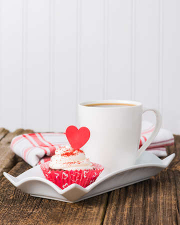 red velvet cupcake: Red velvet cupcake served with a cup of coffee.