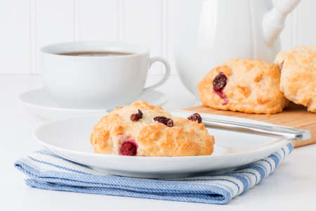 tea and biscuits: Fresh baked cranberry tea biscuits served with hot tea.