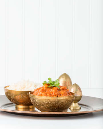 chick pea: Chana Masala, a vegetarian chick pea dish served with white rice. Stock Photo