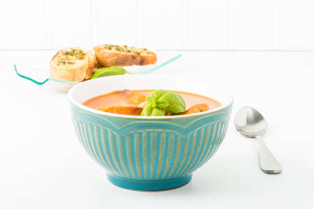 soup bowl: Bowl of creamy tomato basil soup with crostini.  Suitable for many food service marketing applications. Stock Photo