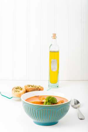 soup bowl: Bowl of creamy tomato basil soup and crostini.  Suitable for many food service marketing applications.