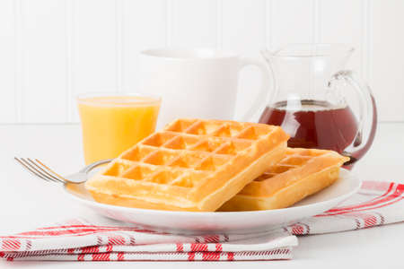 maple syrup: Fresh made waffles with maple syrup, coffee and juice. Stock Photo