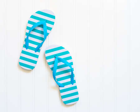 flops: Blue and white beach sandals commonly call flip flops. Stock Photo