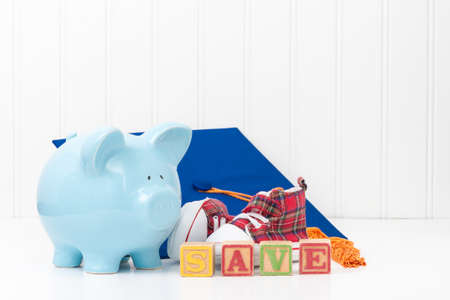 conveys: Piggy bank and infant shoes.  Conveys the concept that it is never too early to start saving.
