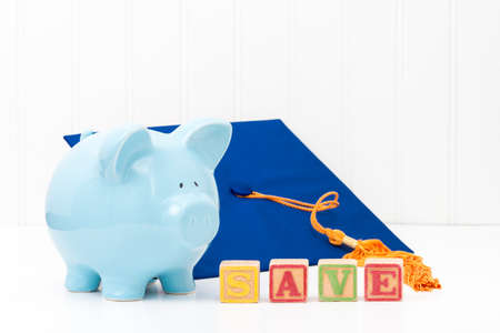 conveys: Blue piggy bank and graduation cap.  Conveys the concept of saving early for education.