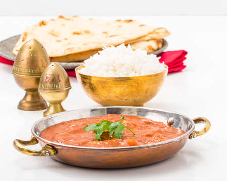 east indian: East Indian meal consisting of butter chicken, rice and nan bread.