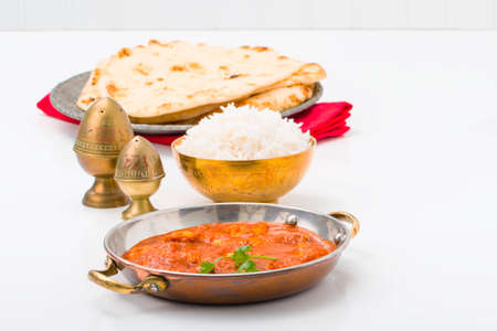 east indian: East Indian table setting with butter chicken and rice. Stock Photo
