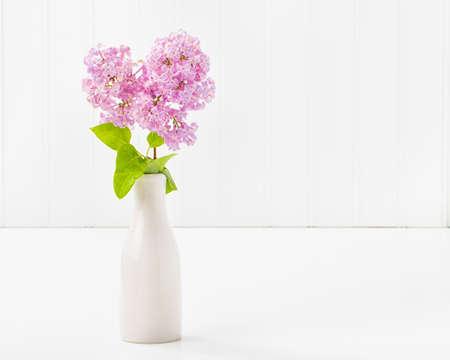 abundant: Beautiful purple lilacs in a vase with abundant copy space.