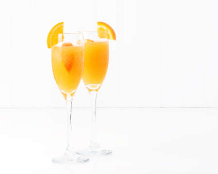 The cocktail known as a mimosa contains orange juice and champagne. Stock Photo