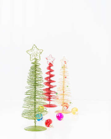 ample: Three colorful stylized christmas trees with ample copy space.