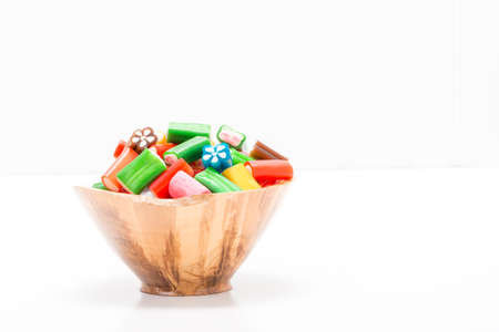 ample: Colorful soft chewy candy in a wooden bowl with ample copy space. Stock Photo
