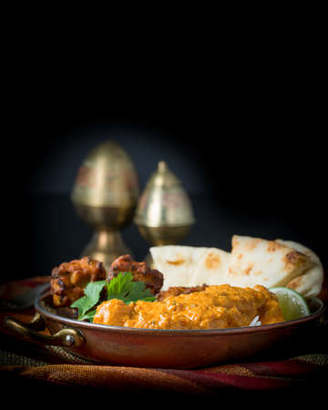 Indian meal consisting of chicken korma, rice, pakoras, and nan bread. Stock Photo
