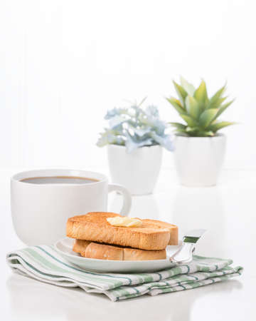 Toast with butter and fresh hot coffee.