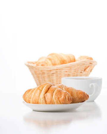 Fresh and delicate croissants served with coffee.