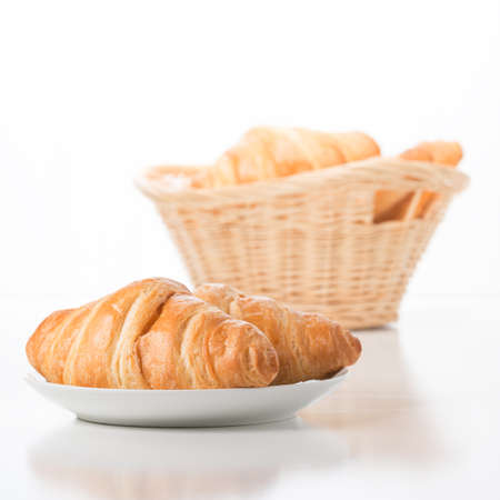 Fresh baked croissants against a white background.