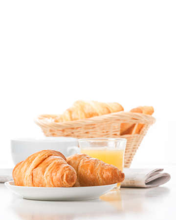 Fresh baked croissants served with coffee and juice.