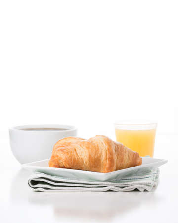 Fresh croissants served with coffee and orange juice.