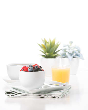 Small bowl of fresh berries served with coffee and juice. Imagens